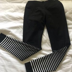 Black leggings with white stripe detail